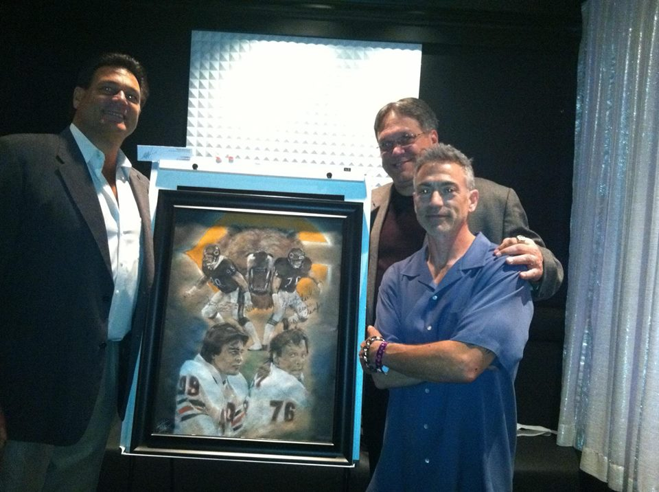 Our fundraiser and artist event with the NFL Players Association Dollars for Scholars event. His piece of Chicago Bear greats Dan Hampton and Steve McMichael raised over $1,000 for a student athlete in financial need.