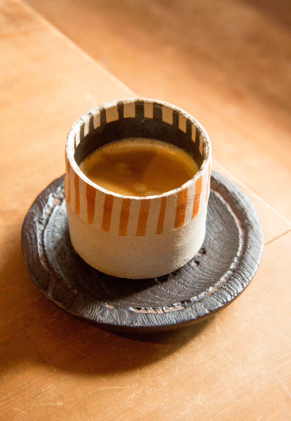 A cup of coffee served in one of Ichino's creations. ©TOKI