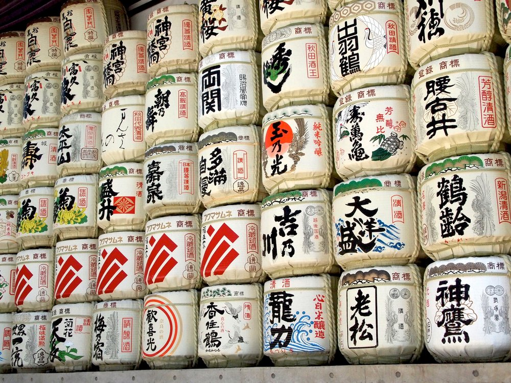 At Meiji Jingu Shrine in Tokyo, empty barrels of sake can be seen on display. Sake is said to bring people and the gods together. ©TOKI
