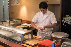 Sushi chef    Yoshi Tezuka