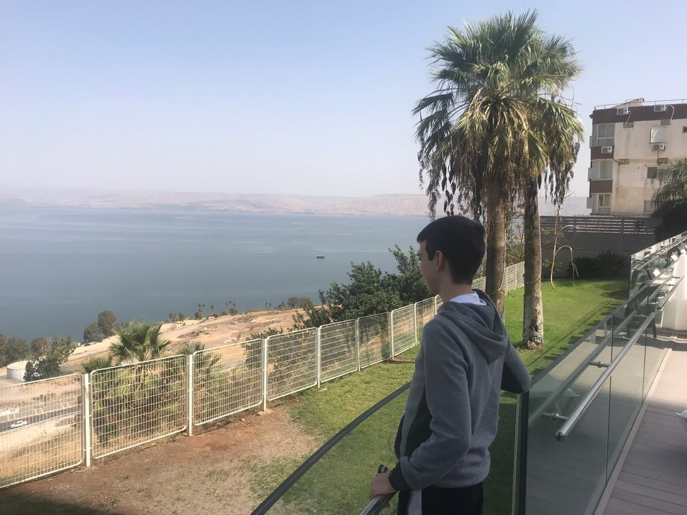 Jack Gilbert looking out on the Sea of Galilee from his hotel room