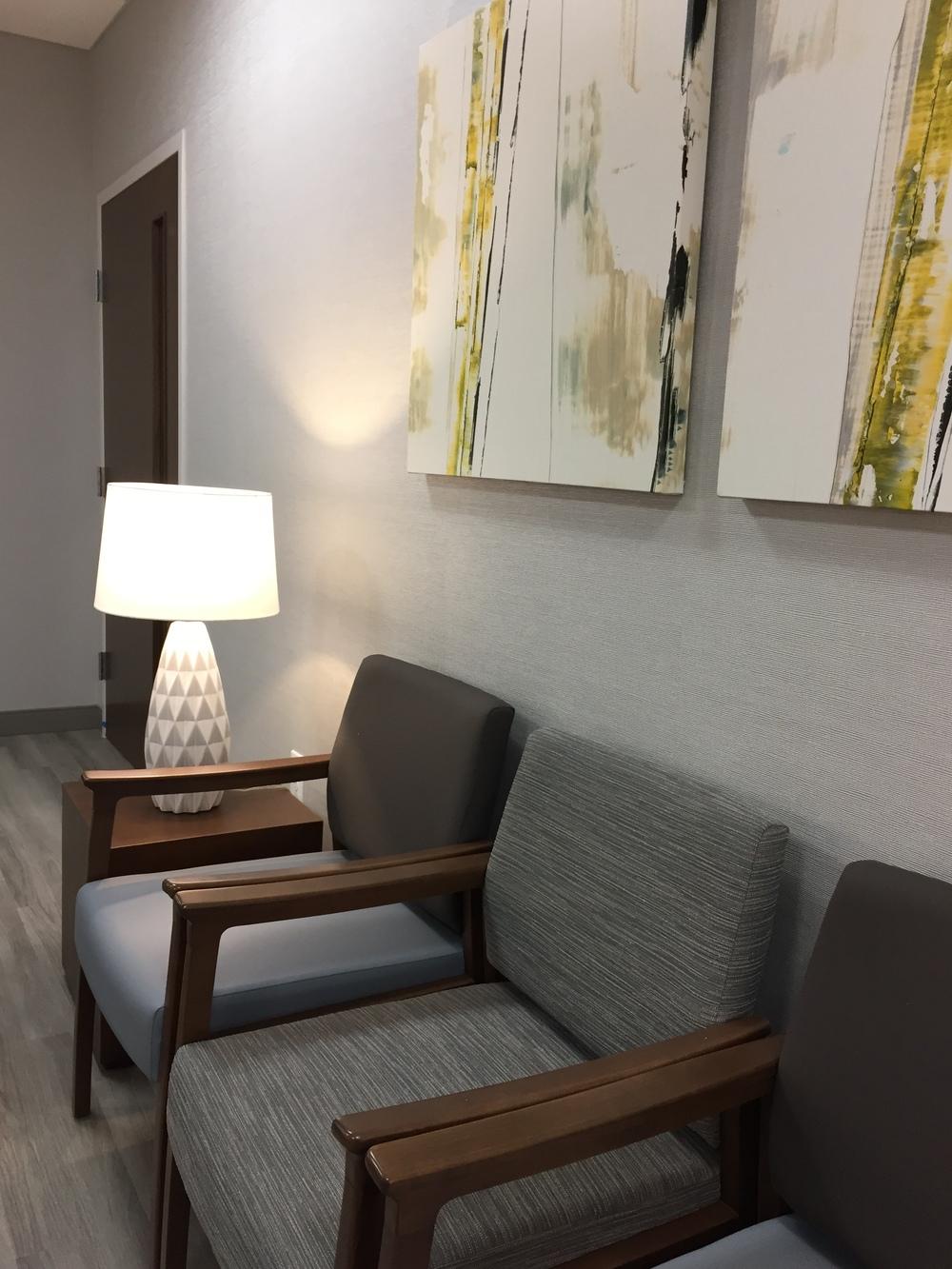 Alexis Pearl Design | Texas Vascular Associates, modern doctors office, grey, Arden Art, Geiger, Crate & Barrel Patina Cube table