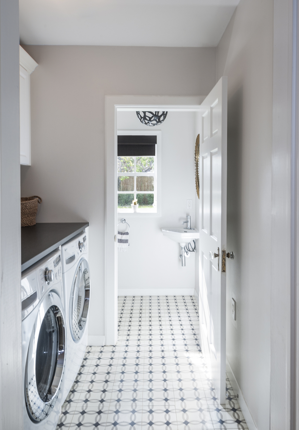 Alexis Pearl Design | Laundry Room, honed black granite counter, Granada cement tile