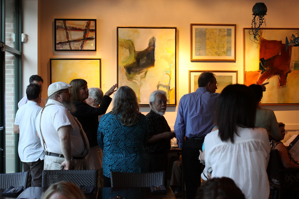 Kevin Rutan's works on display in the main dining room of the restaurant.