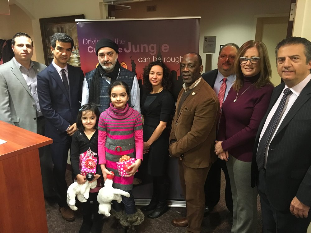 From left to right: Jim Conigliaro Jr., Council Transportation Chairman Ydanis Rodriguez (D-Washington Heights); Shafqat Khan the brother of Roohul Ameen; Farwah Ameen and Hadiyah Ameen, the daughters of Roohul Ameen, TLC Commissioner Meera Joshi; Councilman I. Daneek Miller (D- St. Albans); Ira Goldstein, Executive Director of the Black Car Fund; Diana Clemente, President of Big Apple Car, Inc.; Berj Haroutunian, Chairman of the Black Car Fund.