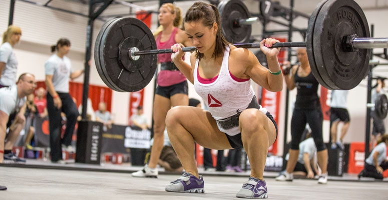 woman performing a squat at the crossfit games