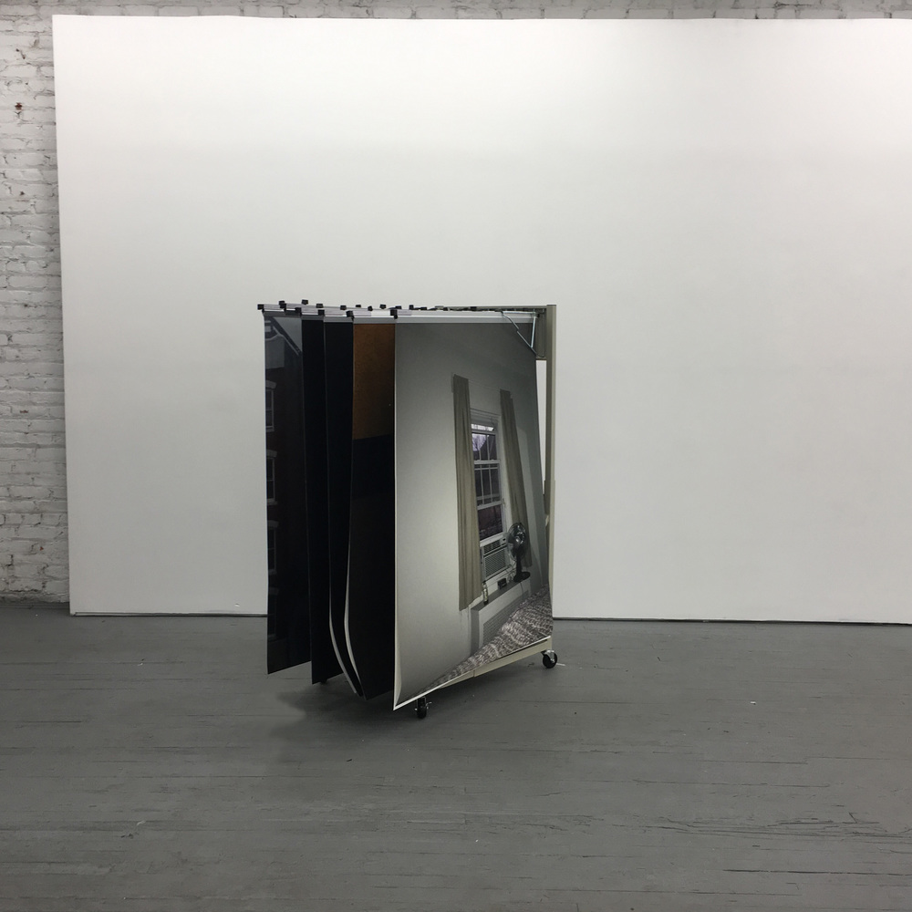 """Soft Archive; Volume I    Installation comprised of large format archival inkjet prints, hanging on steel blueprint rack.  On the back of the rack there is a small brass label with title """"Soft Archive"""""""
