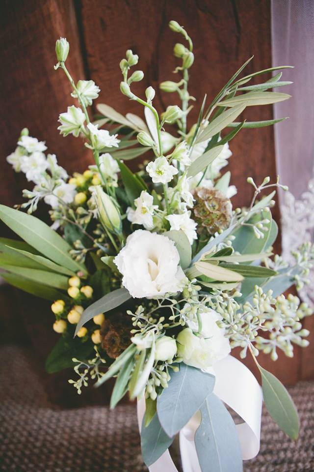 She Ordered Seeded Eucalyptus And Italian Ruscus Garlands To Hang On The Chandeliers Everything Else Was Kept Simple For Bouquets White Larkspur
