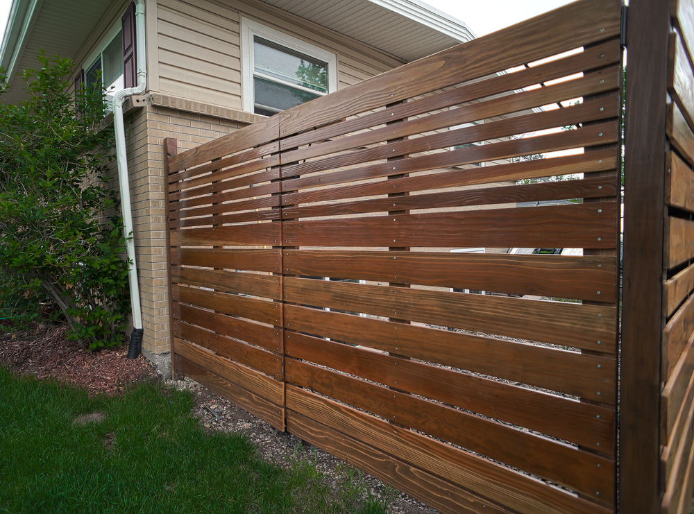 "Peter proves that a ""utility"" gate doesn't have to be a dreadful bore.  Peter is anything but.  He has a nice chocolate color stain on redwood with precise stainless steel screws as an accent."