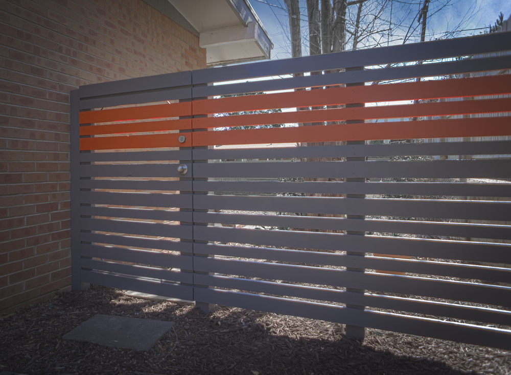 "Patti is a gray slatted entry gate with a ""pop"" of orange.  When we say ""pop""  we mean bam, pow, splat, wowzers, that's a pop of color!"