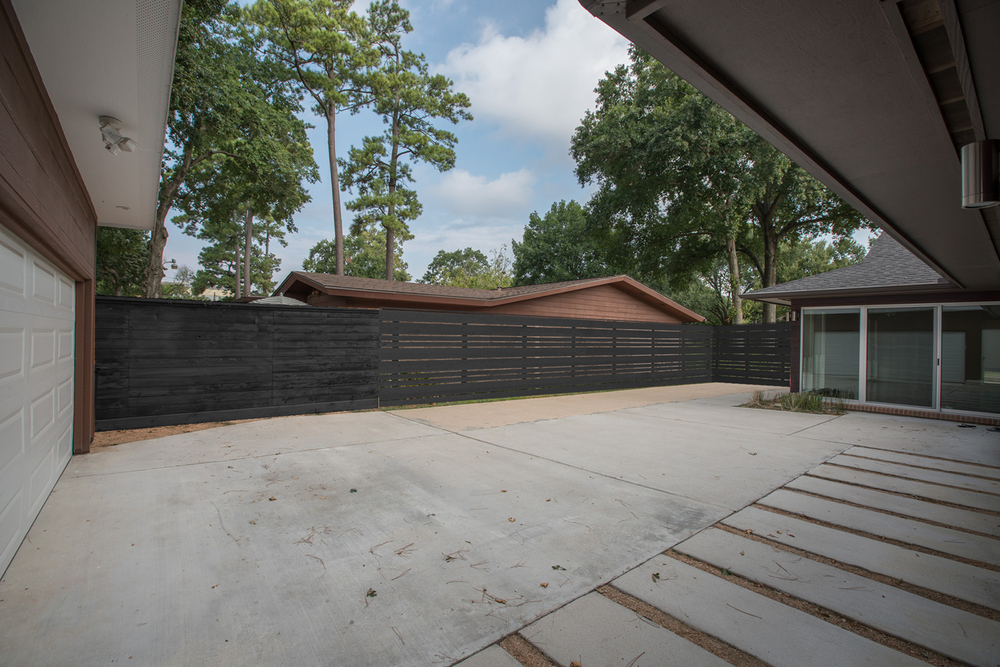 Cedar solid charcoal stain with current fence stained to match