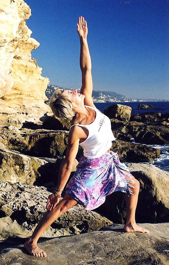 YOGA FOR SURFERS CREATOR PEGGY HALL IS THE PIONEER OF THE GLOBAL SURF + YOGA MOVEMENT