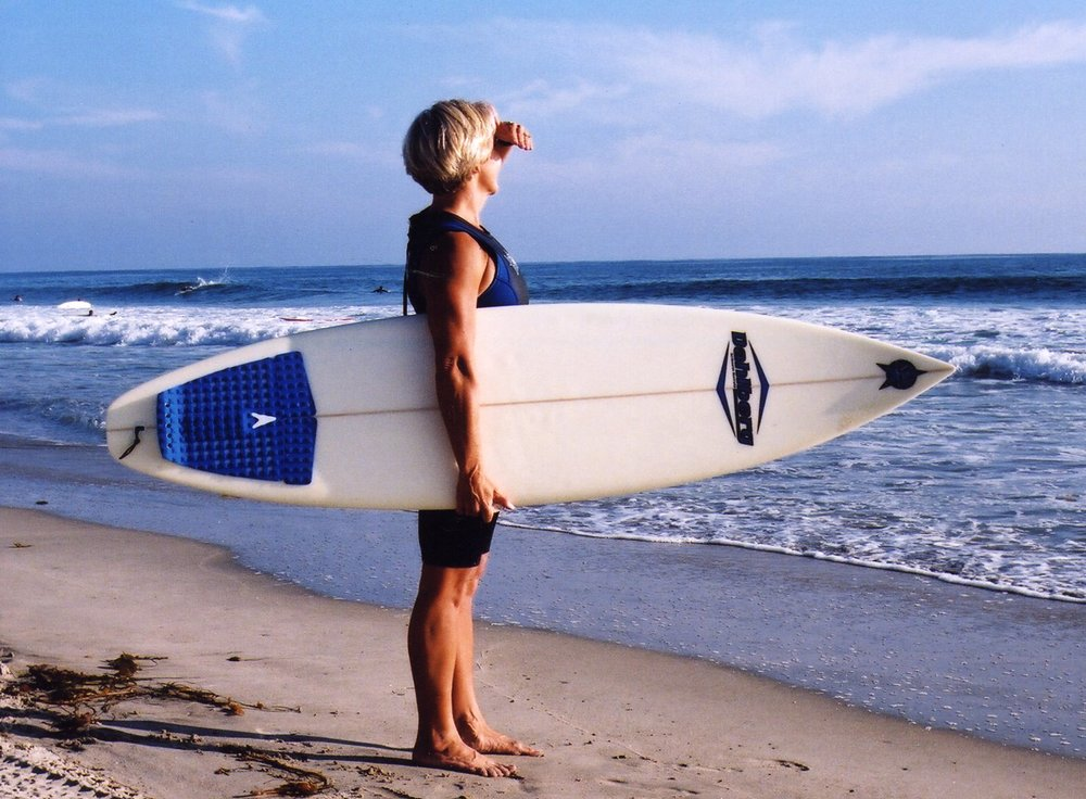 Yoga for surfers creator peggy hall getting ready to paddle out at world-famous trestles