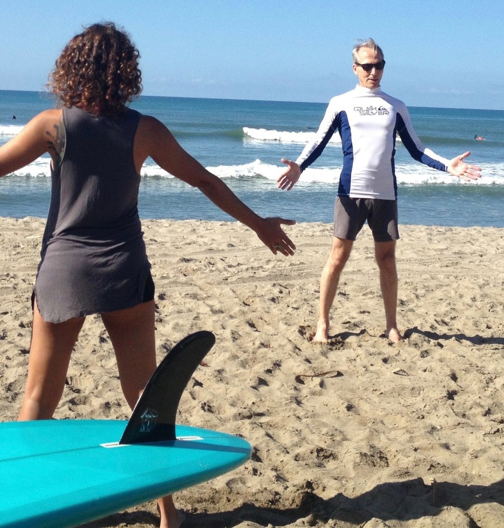 paul leading a pre-surf warmup during the Yoga for Surfers Teacher Training
