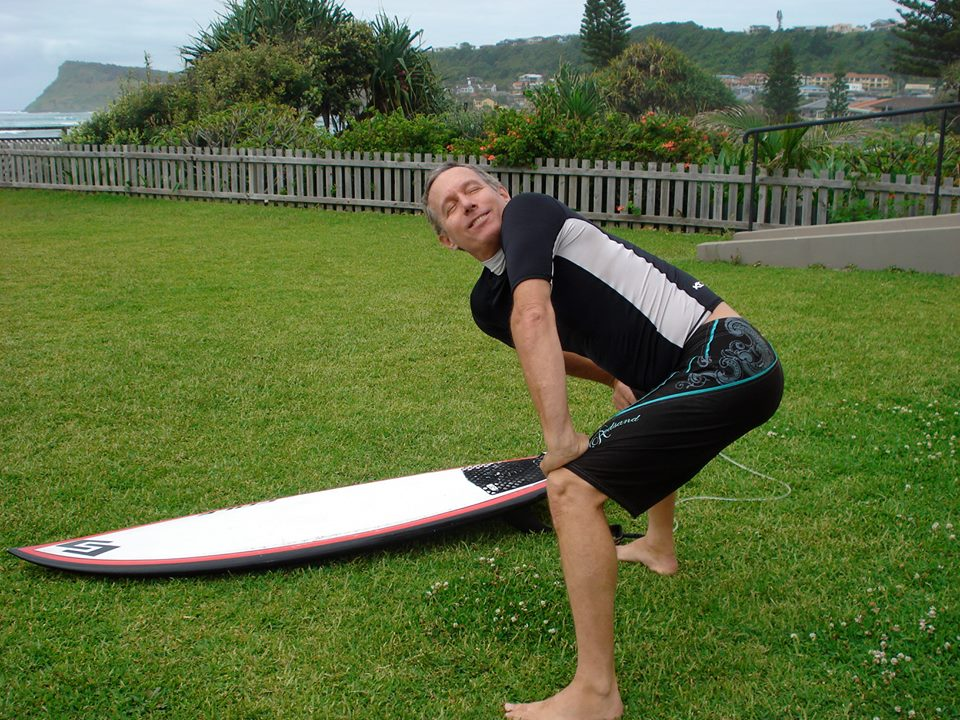 "david doing his favorite pre-surf stretch, ""horsepose twist"" at our Yoga for surfers teacher training in australia"