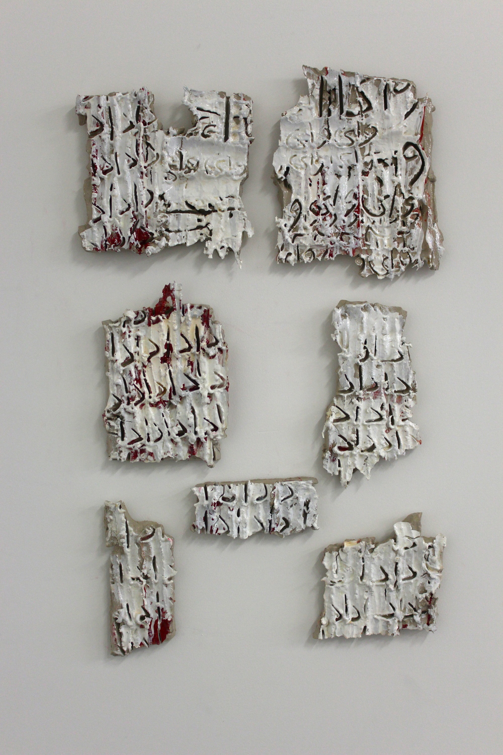 "This installation is made out of a clay painting 40""x30"" on the wall. After drying and falling apart, I collected the broken pieces and put them back together. Inspired by my memories and experiences with the social crisis happening in Iran and their effect on my family life, the installation reveals the tension and frustration of my observation, and my own desire and sensation of loving my family."