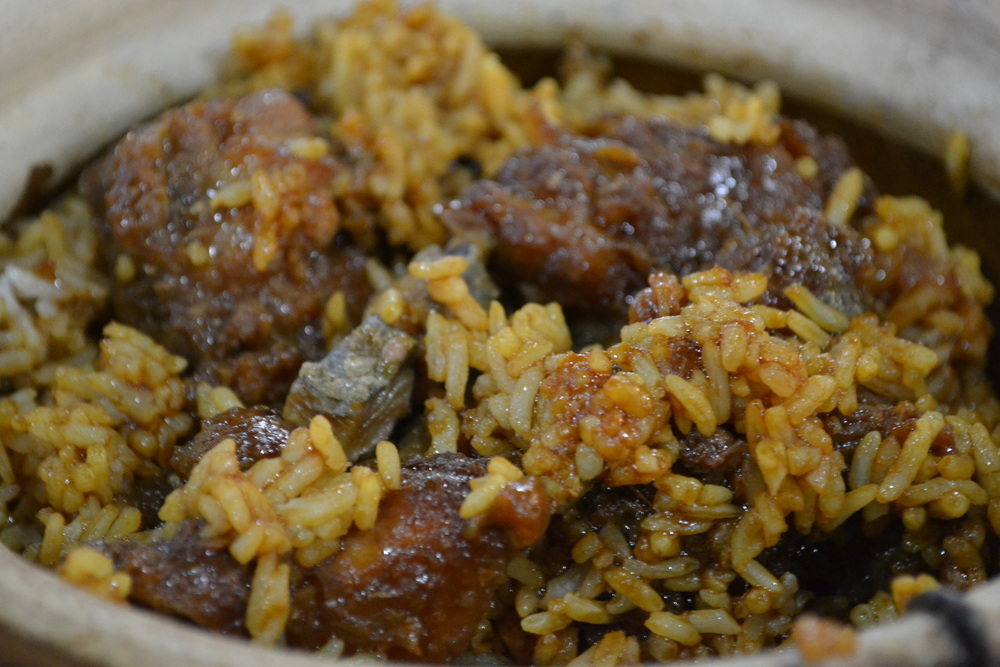 Rice drenched in a brown sauce? Has to be claypot rice.
