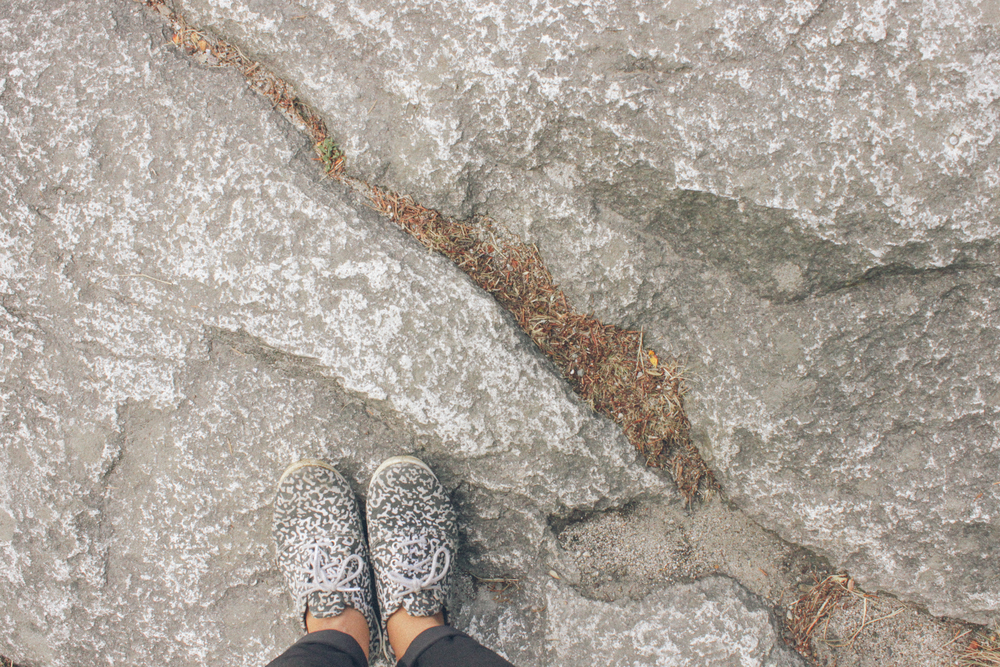 I can already start to feel myself slow down. Taking a quick mindful minute to notice how the speckled pattern of my shoes blend in with the rocks nearby.