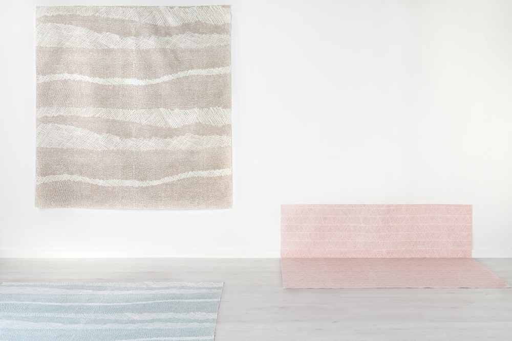 Jean Baptiste Apuatimi's Jilamara design in 'Eucalypt [wall] and 'Inlet' [floor, left] and Osmond Kantilla's Pandanus design in 'Paperbark' [floor / wall].