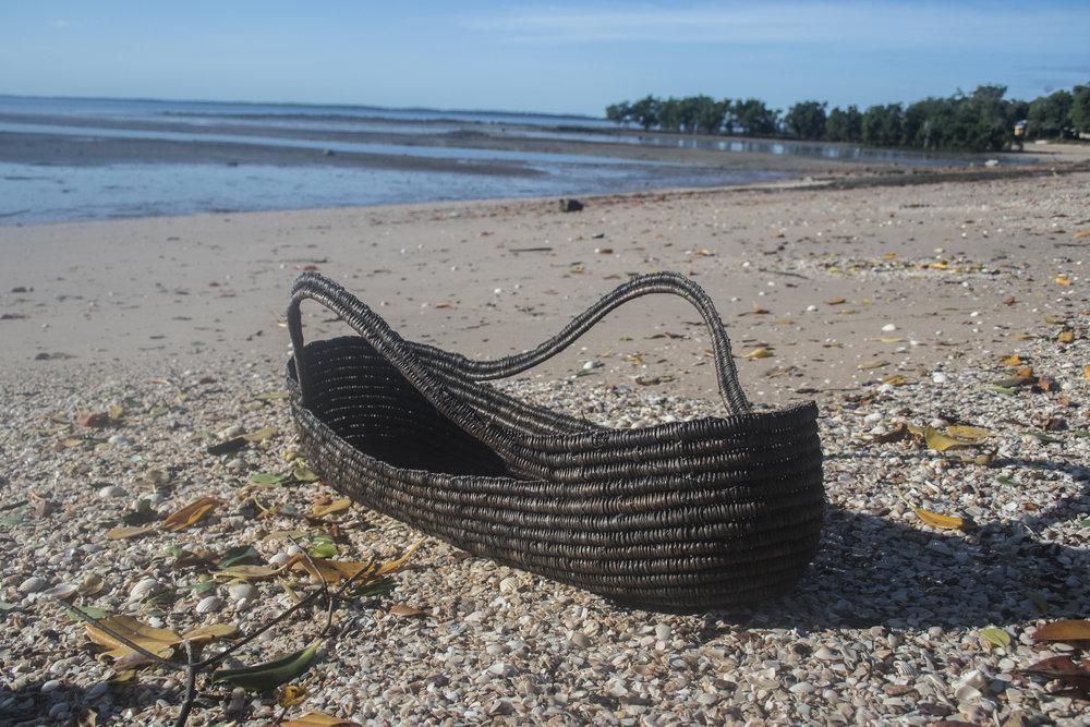 A Yothu Bathi (baby basket) by Margaret Rarru. Photo: Milingimbi Art and Culture.