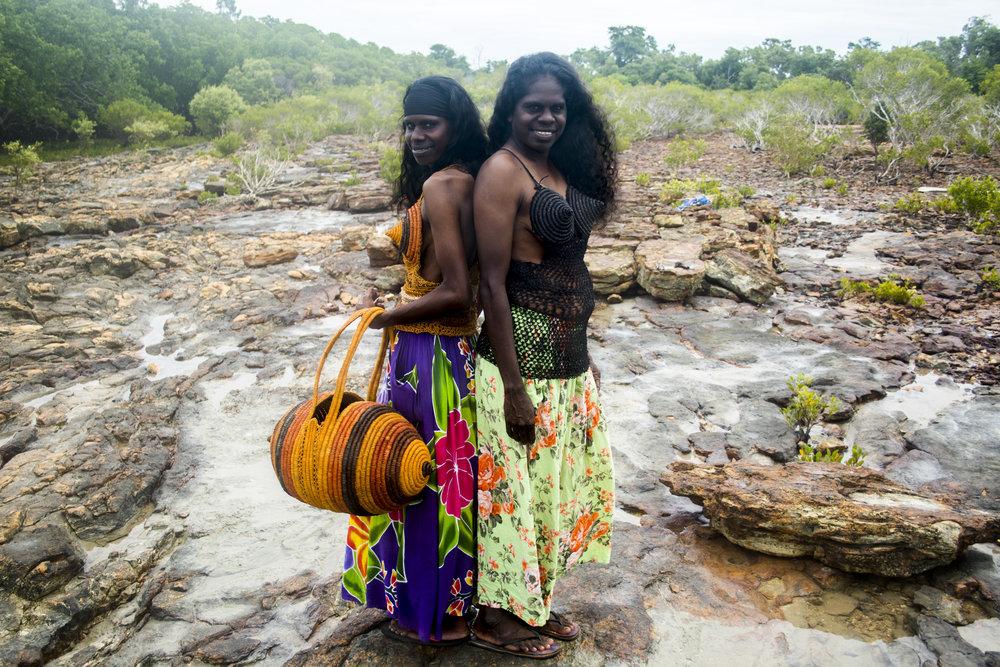 Robin Galitjbirr and Sonya Djndjarrngu modelling Rarru's incredible Madonna Bras and Bags! Photo: Milingimbi Art and Culture.