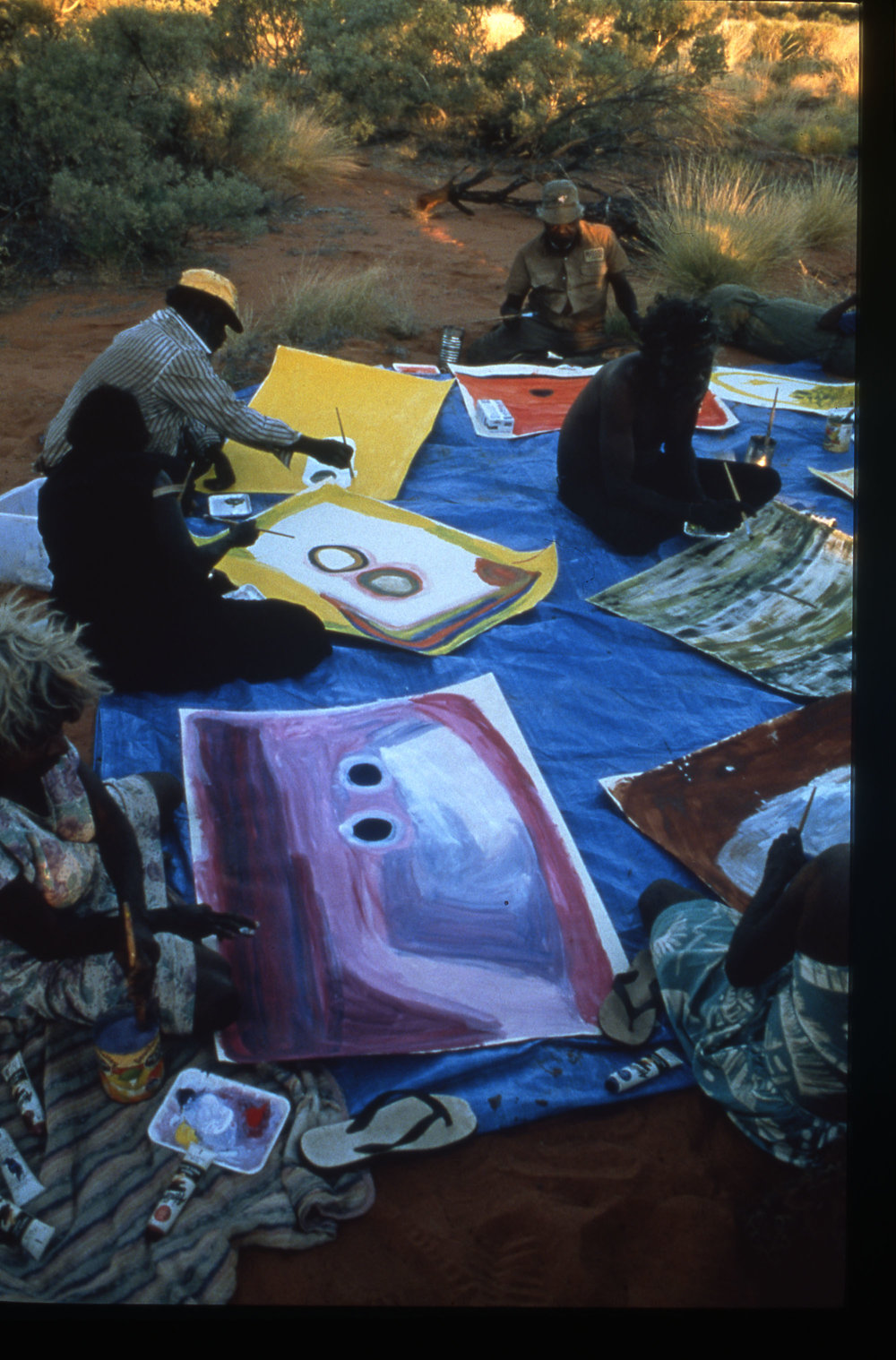 Nada Rawlins painting with Mangkaja artists at Warla, 1996. Photo:  Mangkaja Arts .