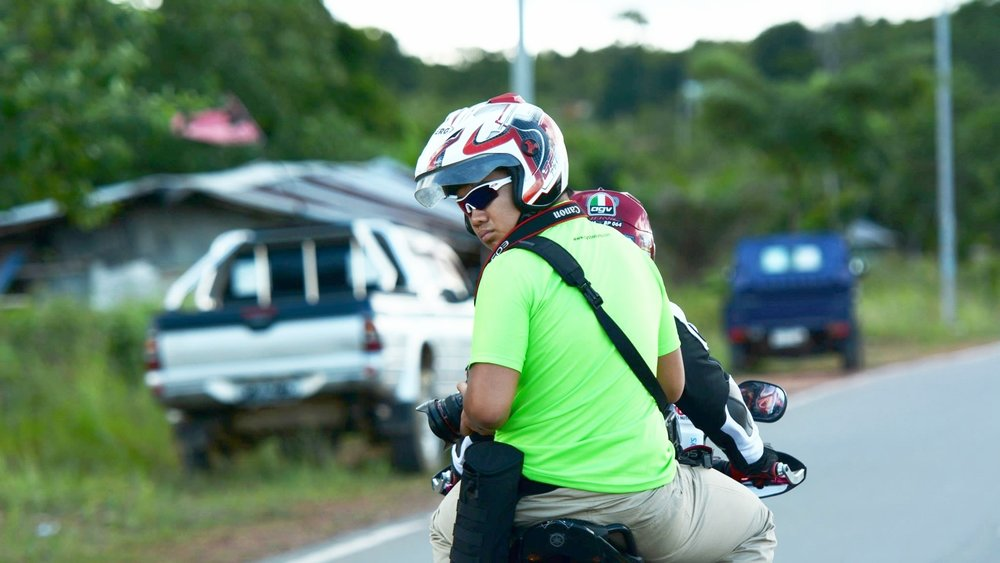 Don't tell my mother, seriously! She didn't know the project involved jumping on the back of a motorcycle chasing a peloton of cyclists while trying to take pictures.  (Tour de Barelang Road Cycling Race/Photo Credits:  Second Wind Magazine )