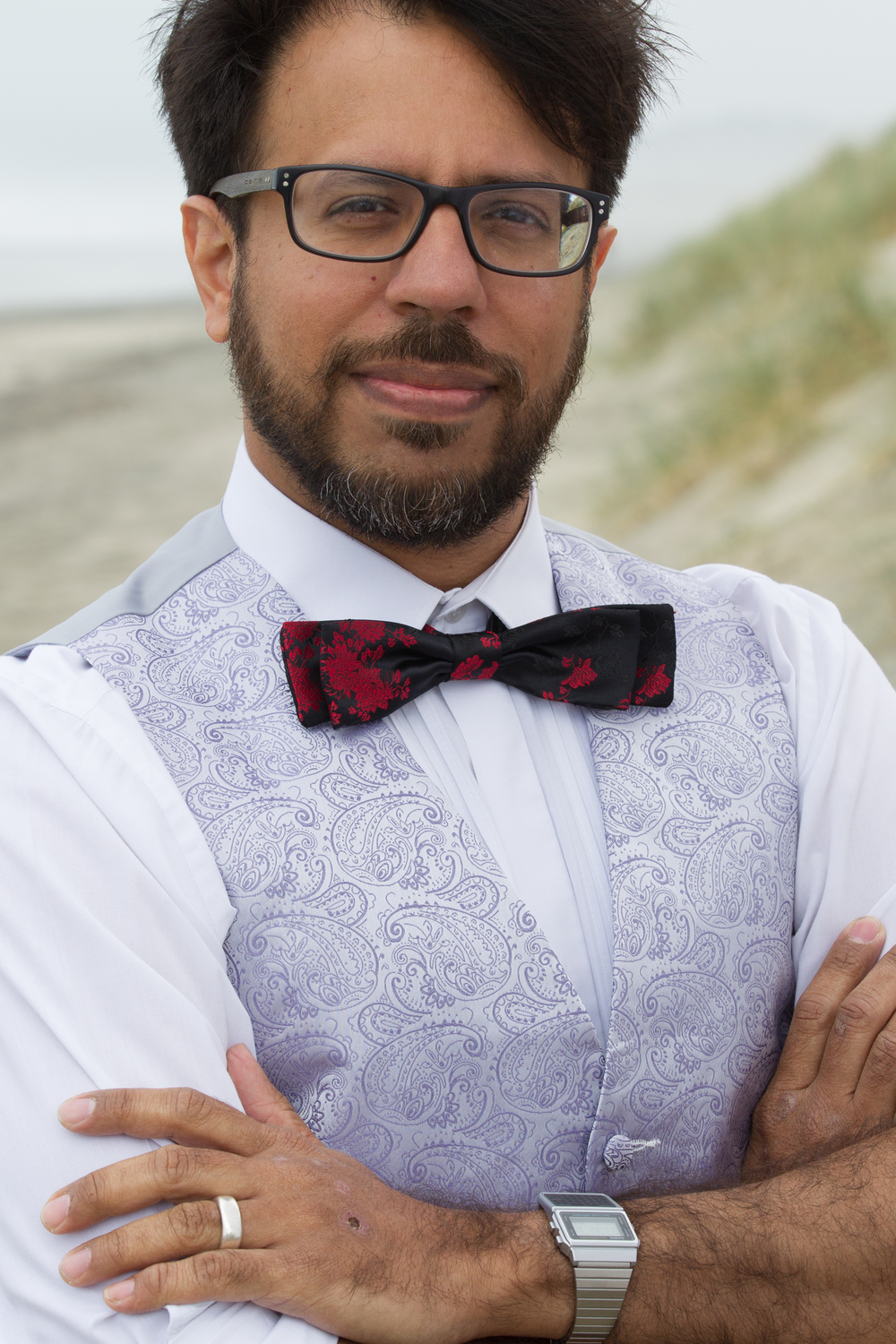 Pair a skinny floral bow tie with a lavender vest for a dapper spring look