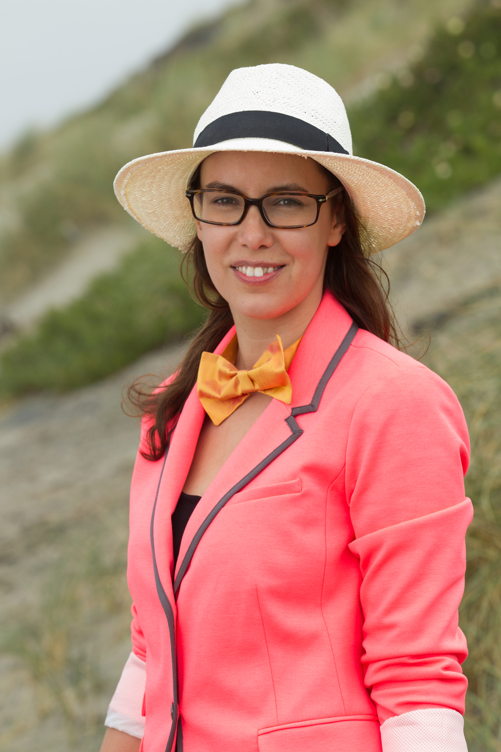 Bold color bow tie compliments a neon blazer