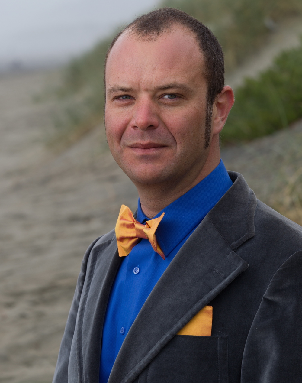 Gold bow tie and pocket square combined with a fun blazer to dress it up