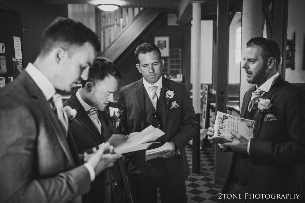 Dutifully, the groomsmen and ushers get to work and greet the guests as they arrive to church.