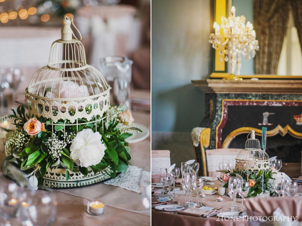Taupe and Ivory with peach accents made up the colour theme for the wedding breakfast tables that were adorned with bird cage centrepieces and lace table runners..