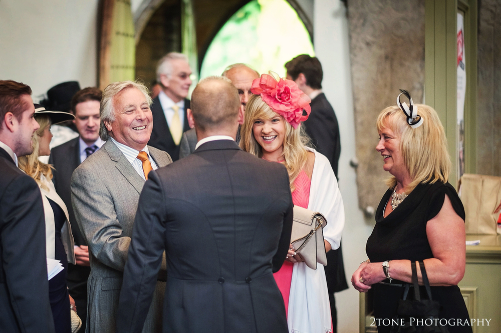 Guests arrive to church.  St Brandon's church, Brancepeth, Durham.  Wedding photography by www.2tonephotography.co.uk