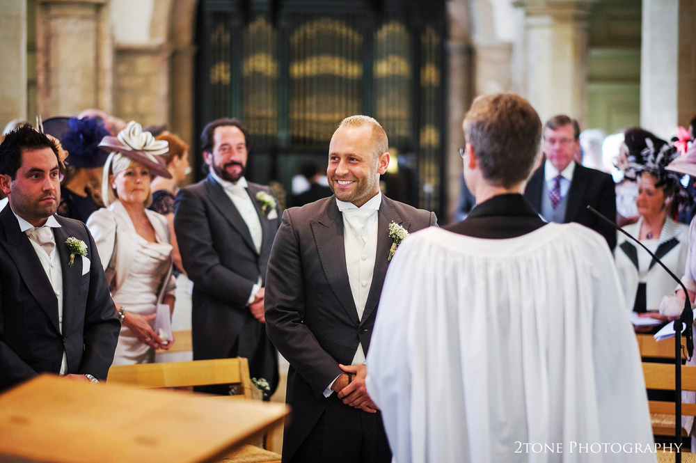 Groom waits in church for bride's arrival.  St Brandon's church, Brancepeth, Durham.  Wedding photography by www.2tonephotography.co.uk