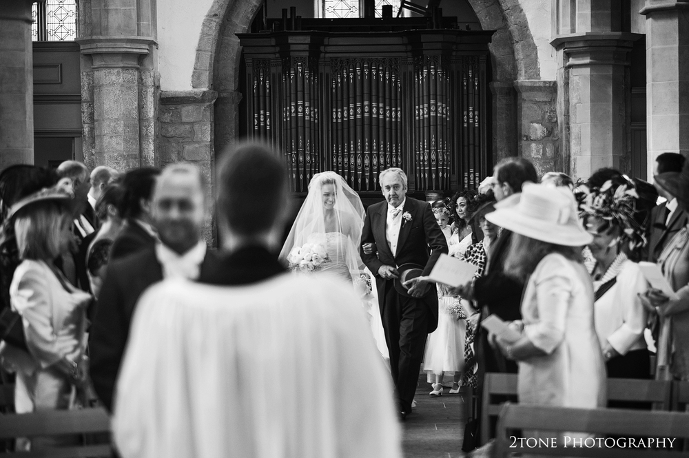 Bride and her father walk down the aisle.  St Brandon's church, Brancepeth, Durham.  Wedding photography by www.2tonephotography.co.uk