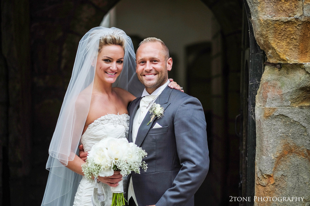 Bride and Groom at St Brandon's church, Brancepeth, Durham.  Wedding photography by www.2tonephotography.co.uk