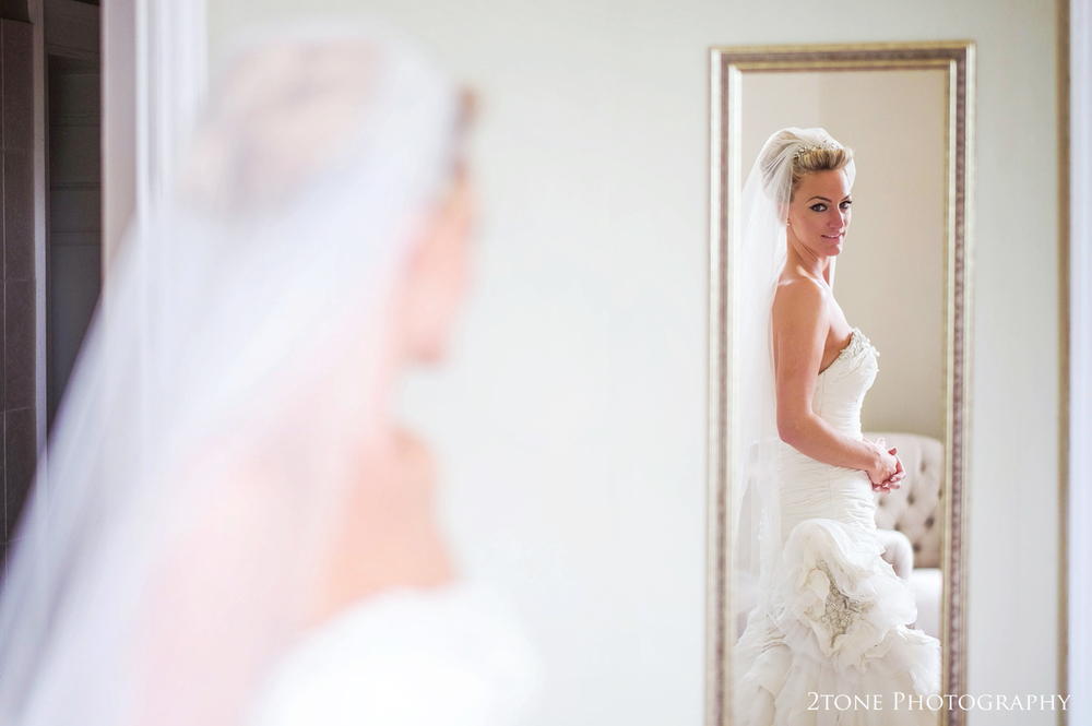 Bride in the bridal suite at Middleton Lodge.  Wedding photography by www.2tonephotography.co.uk