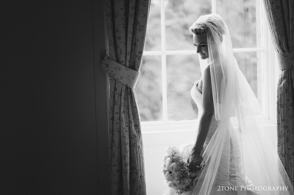 The soft delicate light of the day gave us the opportunity to capture this beautiful image of Sarah standing in the window of the bridal suite in Middleton Hall