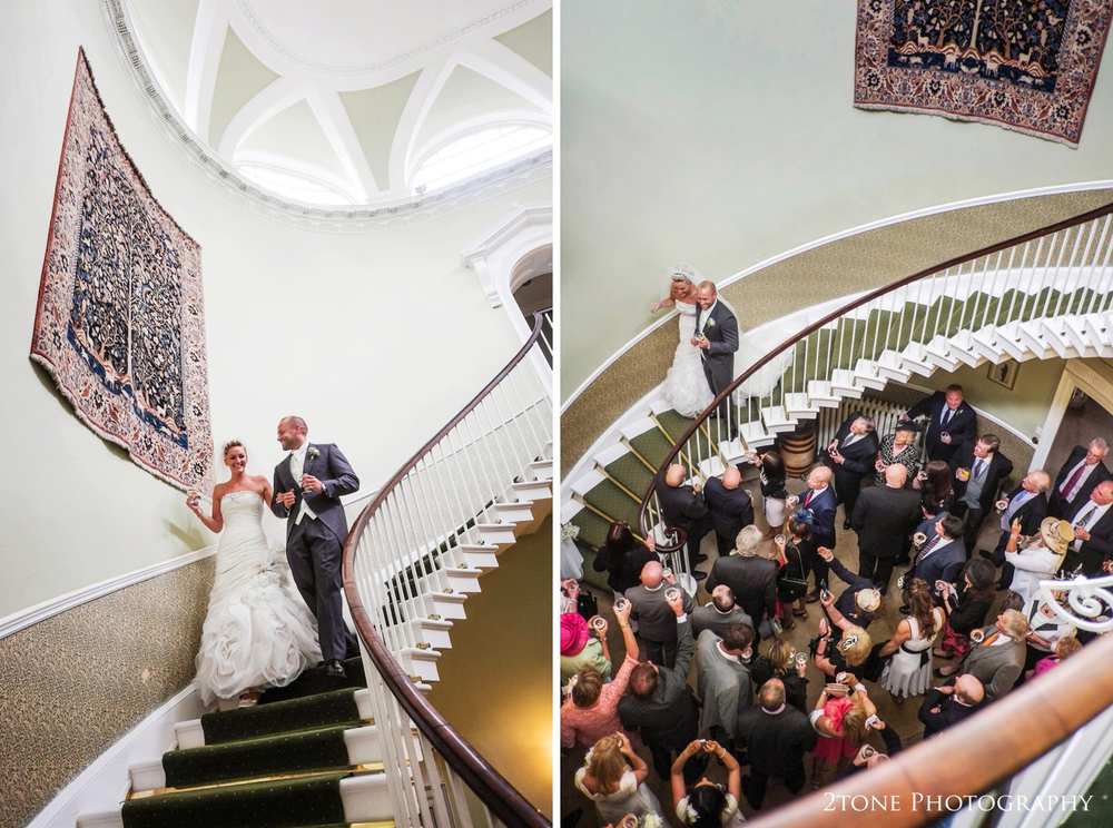 Not long later, Sarah and Christian descend the winding staircase to join their wedding guests.