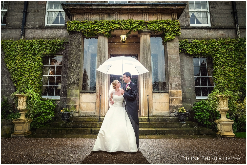 Rain on your wedding day doesn't have to be a bad thing.  Rain can bring us a whole new set of possibilities such as reflections in puddles and this, look very carefully and you shall see how the rain droplets have been lit from behind so make them more clearly visible.  Romantic and charming.