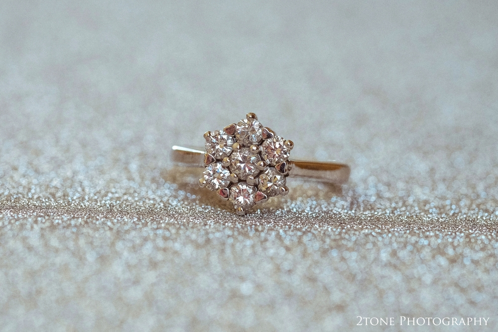 Hannah's stunning seven stone diamond engagement ring set with tiny heart heart shaped claws.