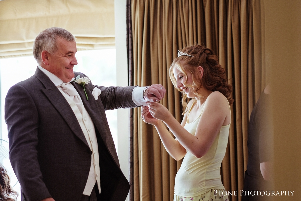 A great father and daughter moment.  Nicola's dad is beaming with pride for his daughter as she helps him with his cuff links.