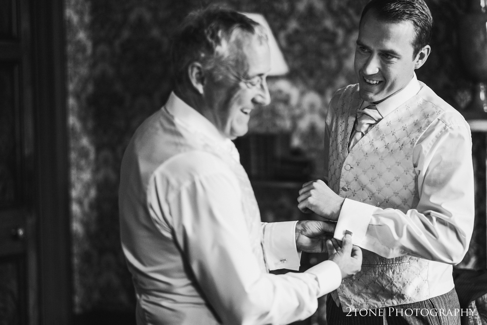 Groom's preparations at Wynyard Hall.  Wedding photography by www.2tonephotography.co.uk