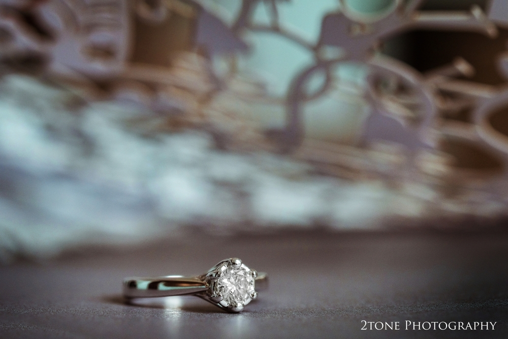A creative shot of Sonia's engagement ring, sitting inside the laser cut wedding card that she had been given from Craig.