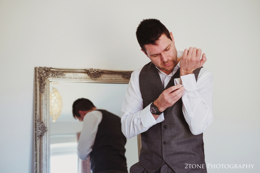 Groom's preparations for his wedding at Doxford Hall.  Wedding Photography by Durham and Newcastle wedding photographers www.2tonephotography.co.uk