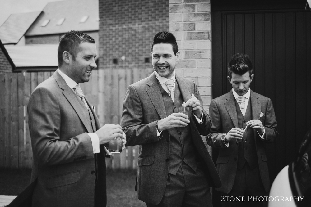 Groomsmen leaving the house for the wedding at Doxford Hall.  Wedding Photography by Durham and Newcastle wedding photographers www.2tonephotography.co.uk