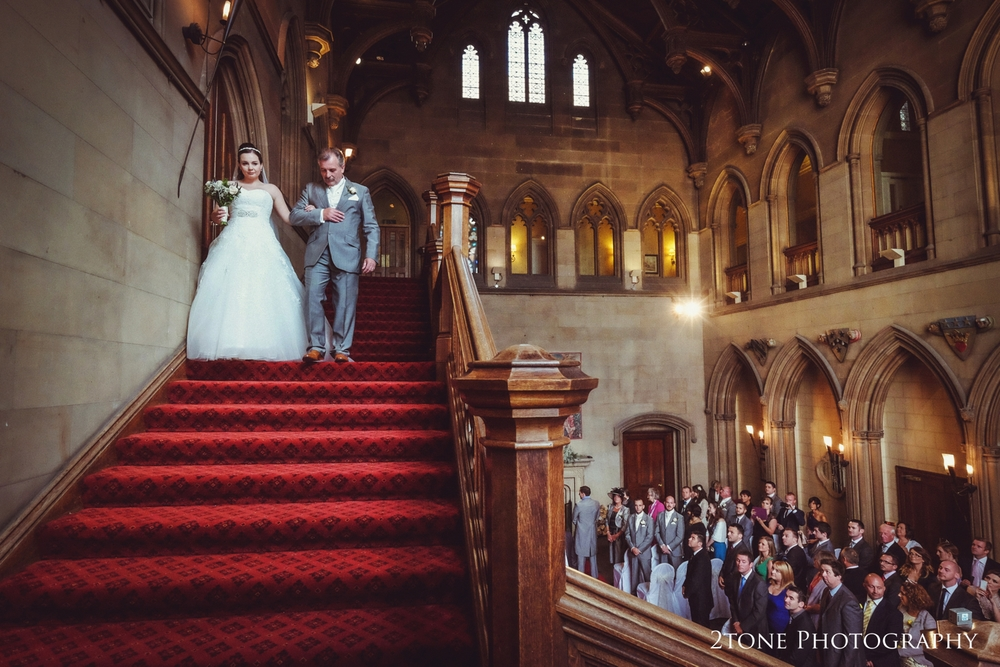 Beautiful Natalie walks slowly down the great hall staircase.  Such a proud moment for her and her father, I carefully positioned myself so we can see her clearly ascend the staircase while we can also see their guest looking up watching her with Russell up at the back - sticking to tradition and not turning.  Viewing these images allows Natalie to relive the moment and Russell to witness something that he did not with his own eyes.