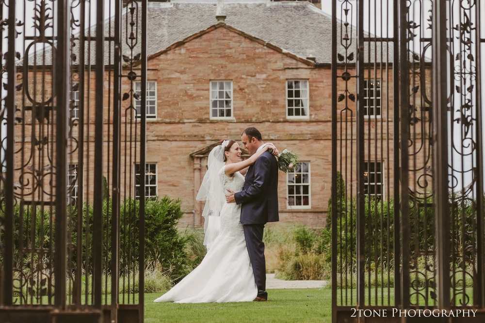 We lovingly refer to this construction as the 'birdcage'.  It some kind of Arbour I think - but what ever it's proper name is it does make for some more great shots of our couple with a fab view of the hall behind.