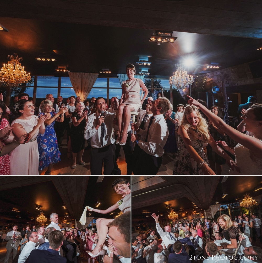 The traditional Jewish celebration dance, the Hora begins, the bride and groom and then the parents of the couple are hoisted up on chairs as the wedding guests dance around them.  The energy in the room was incredible.