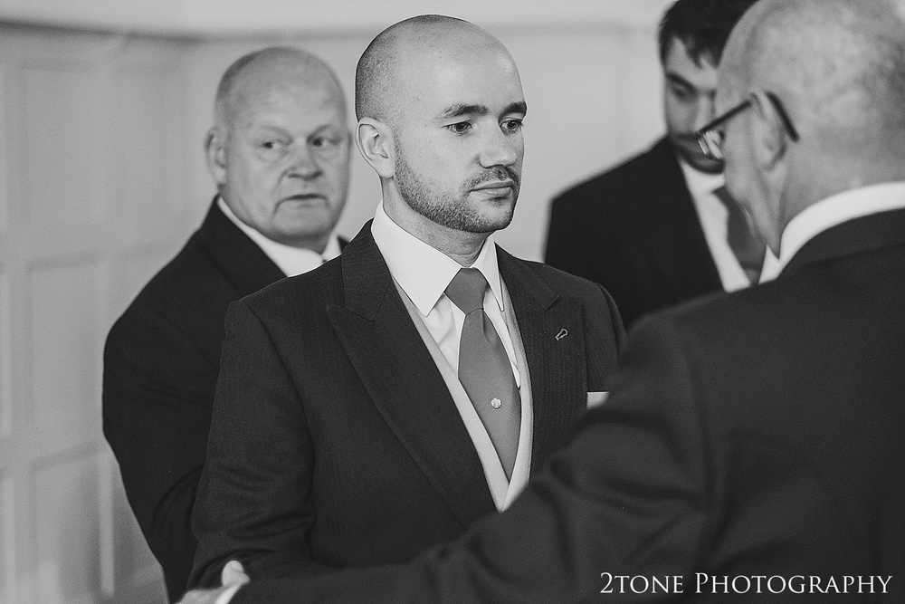 Groom getting ready.  Lartington Hall Wedding photography by www.2tonephotography.co.uk